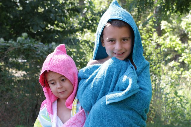 There's nothing like staying wet to beat the heat. But when it's time to dry off, don't just use any old towel–wrap your kids up in a fun towel they can wear. These cute hooded towels are not only great for the beach, but they can double as a year round bath towel.
