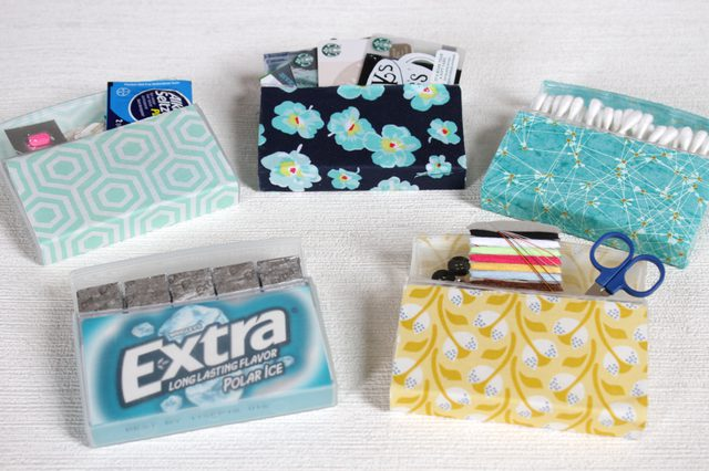 But what to do with these great little containers when all the gum is gone? Instead of throwing your handy dandy little boxes out, cover them with some pretty fabric and fill them with travel items to keep yourself organized and prepared no matter where you plan on going.