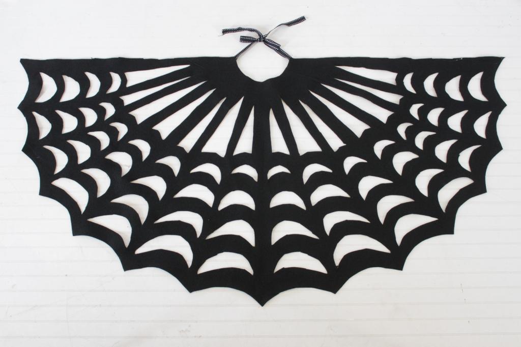 finished diy spider web cape